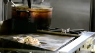 Food simmering on a grill video