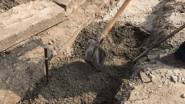 Foot of worker with shovel. video