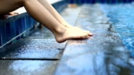 foot on the edge of swimming pool video