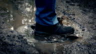 Foot Splashes Muddy Puddle video