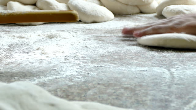 4K footage, Closeup hand of chef baker making pizza at kitchen video