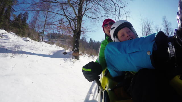 4K Footage: Father and son on the Bobsleigh attraction during winter holiday. video