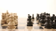 Footage of a chess board isolated on white background, the shot comes into focus and goes again out of focus video