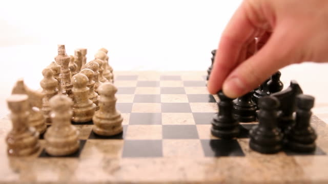 Footage of a chess game isolated on white background, the players started a new game video