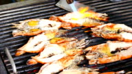 HD Footage of chef Cooking seafood on barbeque grill. Grilled Giant River Prawn video