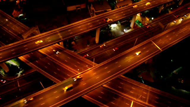 HD Footage of massive expressway at night from top view, transportation industrial concept video