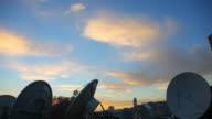 Footage of several satellite antennas at sunset video