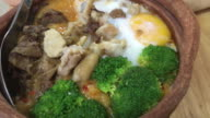 4K footage : Rice congee soup in Clay pot , traditional food of Bangkok , Thailand. video