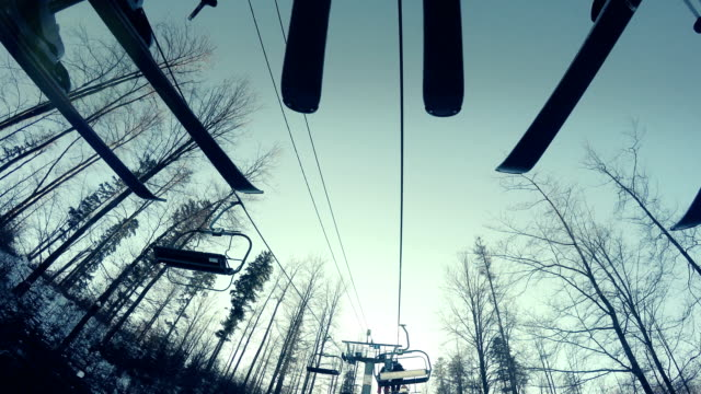 4K footage: Skiers' ski on the moving lift video