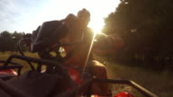 4K footage:  son with father riding by the quadrocycle front camera view video