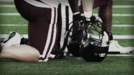 Football athlete taking a knee video