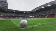 DS Football ball in corner of an empty stadium video