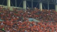 Football fans celebrate a goal. Unrecognizable crowd video