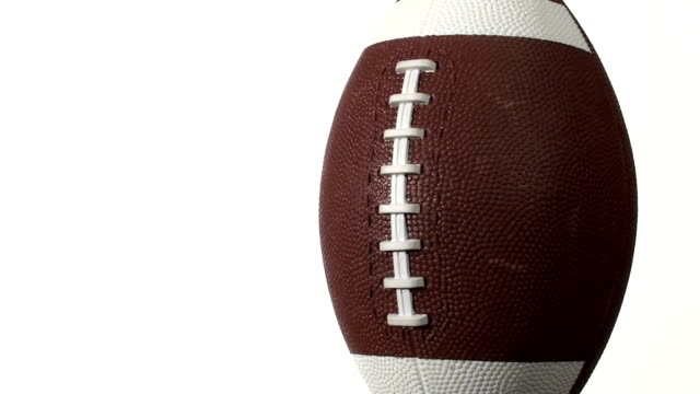 Football isolated against white - HD video