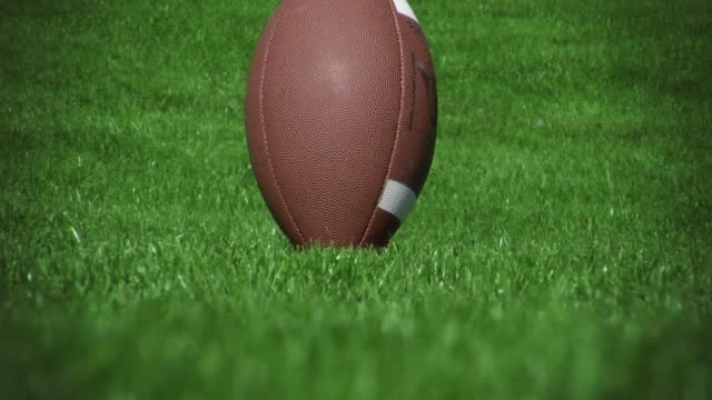 Football kicked off tee 01 (HD - Slow-Motion) video