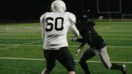 A football player catches a pass and makes a touchdown in slow motion video