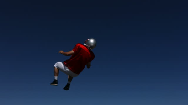 Football player does back flip, slow motion video