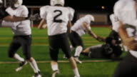 A football player gets the ball handed off to him and he makes a touchdown video