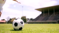 Football player kicking the ball video