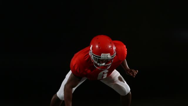 Football player running towards camera, slow motion video