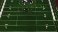 Football players line up at the line of scrimmage, birds eye view from high up video