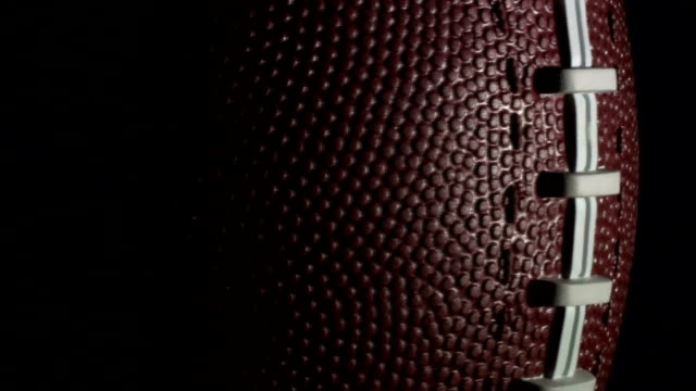 Football rotates in slow motion - HD video