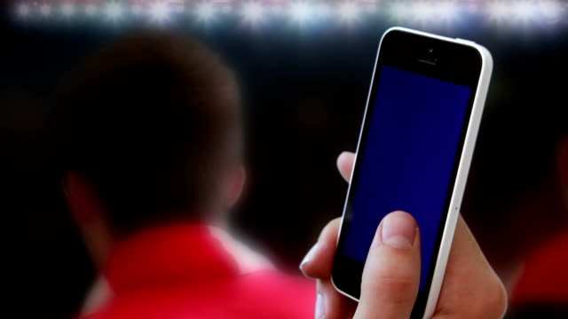 Football smartphone cheering fans. video