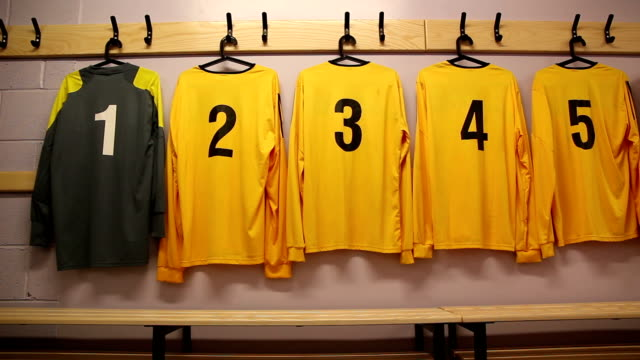Football / Soccer kit hung up in changing locker room video