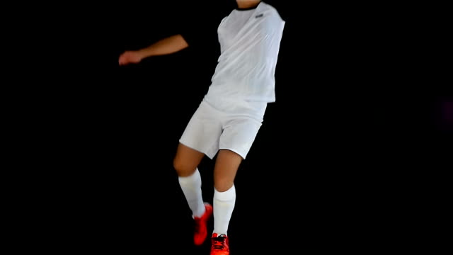 Football soccer player jumping and kicking the ball video