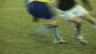 Football / Soccer players competing for the ball in Match video