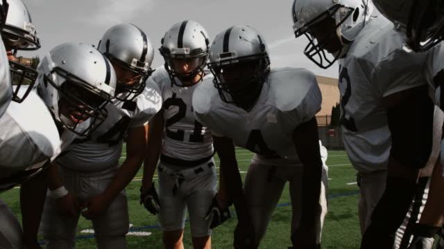 Football team huddles up. video