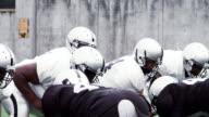 Football team protects Quarterback. video
