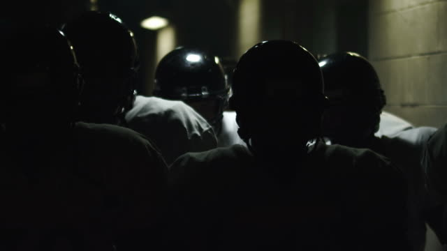 Football team walks toward the camera video
