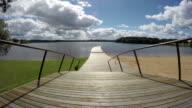 Footbridge to the lake, time lapse video