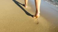 Footprints on the Mediterranean beach video