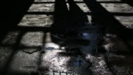 Footsteps of a man passing by in a scary,dark room video