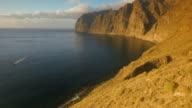 Forbidding coast of the island in the open ocean. Top view of the cliffs video