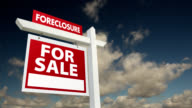 Foreclosure Home for Sale Real Estate Sign with Time-Lapse Clouds video