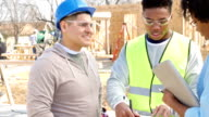 Foremen update charity executive on progress of home built for charity video