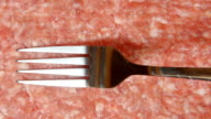 CLOSE UP: A fork is moving on a fresh forcemeat video