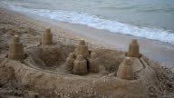 Fortress from sand on the sea beach. video