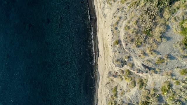 forward overhead aerial on mediterranean sea wild coast, blue water.Nature environment outdoors travel establisher,Italy,Sicily Salina Eolian Island.Sunny summer.4k drone top view establishing video video