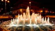 Fountain illuminated at night video