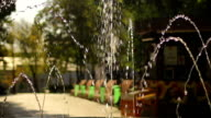 Fountain water splashing in green city park. Place for family rest and leisure video