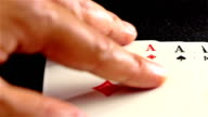 Four Aces on black poker table video