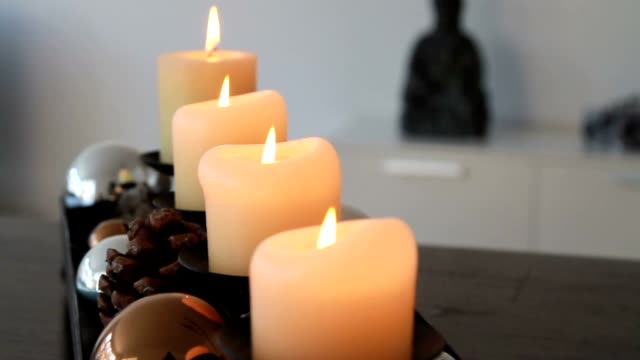 Four burning candles in advent video