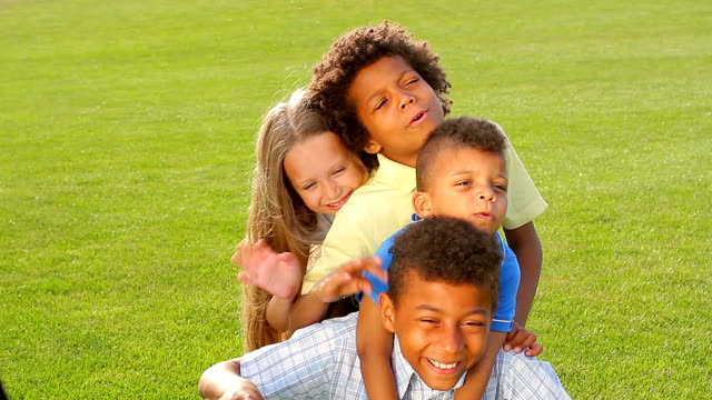 Four children are playing on the grass. video