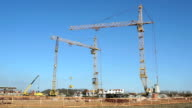 Four construction cranes working on the site video