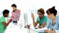 Four creative designer working together video