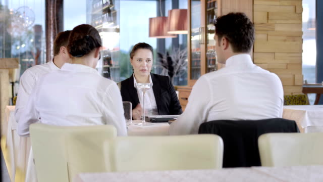 HD DOLLY: Four Executives Working At The Café video